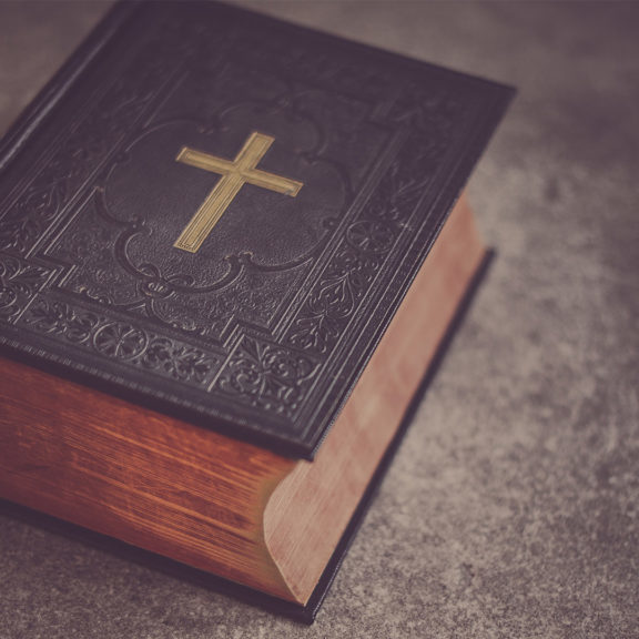 black-Bible-on-gray-surface