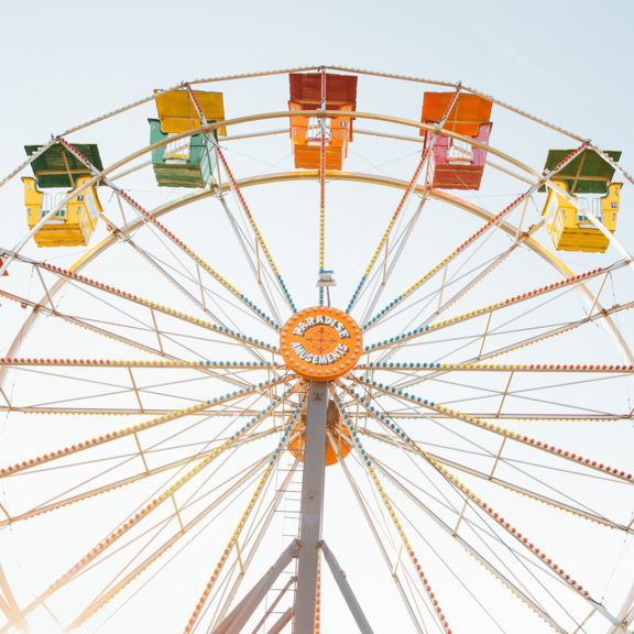 worm's-eye-view-of-red-orange-and-yellow-Ferris-wheel